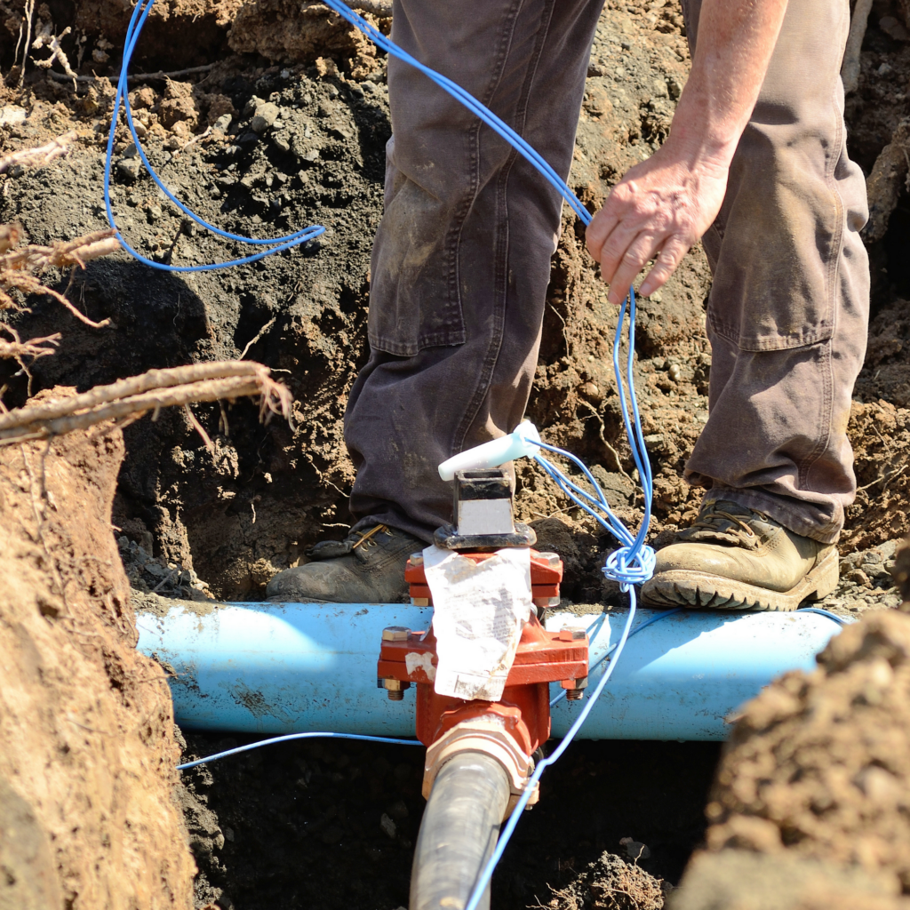 Underground water line with a blue tracer